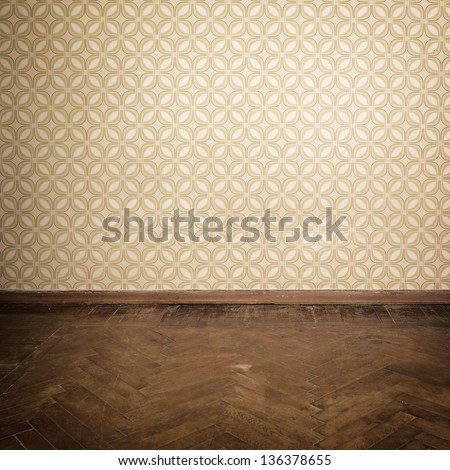 Vintage room empty retro apartment with old fashioned wallpaper and weathered wooden parquet floor toned