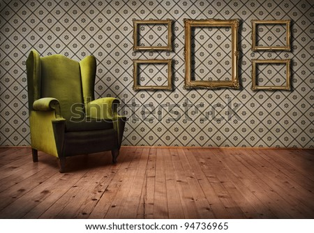Vintage room interior with wallpaper, retro golden picture frames and old fashioned armchair.