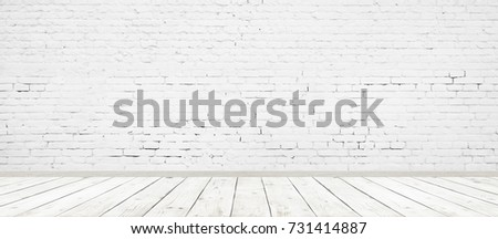 Vintage room interior with white brick wall and wood floor background. Wide panorama image