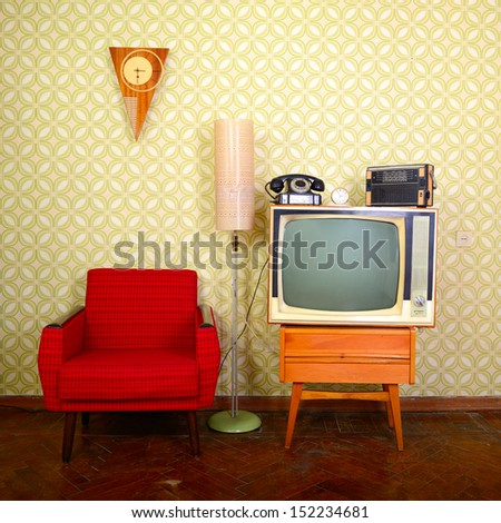 Vintage room with wallpaper old fashioned armchair retro tv phone clocks radio player and standart lamp