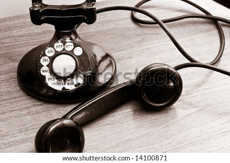 Vintage Rotary Dial Telephone with sepia look to it.