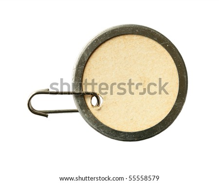 vintage round cardboard and metal tag isolated on white