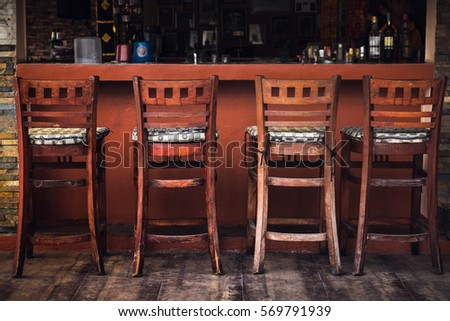 Vintage Row of wooden chairs, Interior background , Brown wooden chairs near the wooden bar of the bar