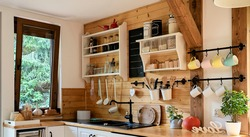Vintage rustic kitchen in wooden cottage with window and kitchenware. Interior with wooden wall and mug in rural style. Banner