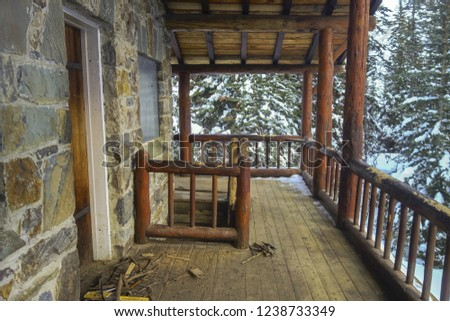 Vintage Rustic Tea House Log Cabin Wooden Porch on Plain of Six Glaciers Hiking Trail in Winter, Banff National Park Canadian Rocky Mountains