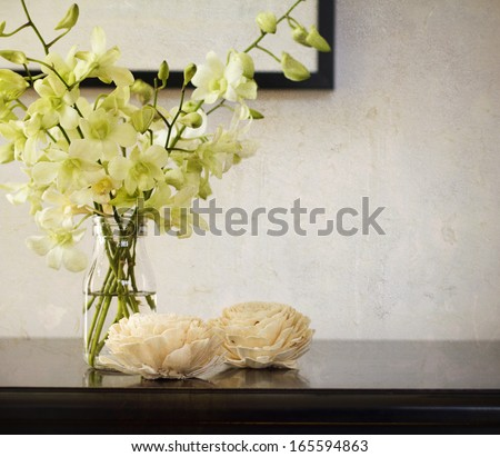 Vintage rustic texture behind orchids in glass vase #165594863