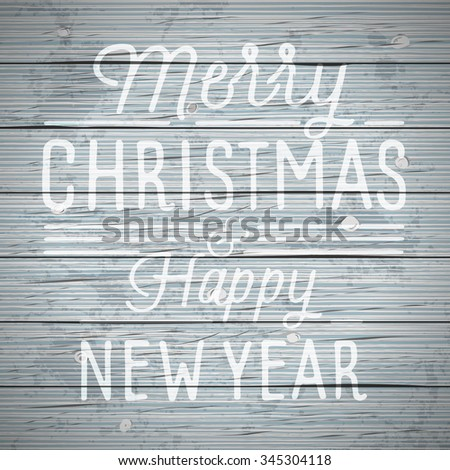 vintage rustic wood background with slogan for christmas and new year holidays