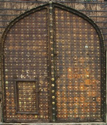 vintage rusty arch door,The carved wooden church door gate of the Basilica of the holy cross in Florence background