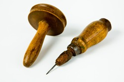 Vintage rusty awl with wooden grip and darning tool, old tailor's tools