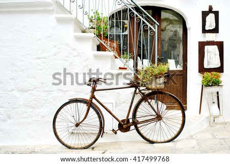 vintage rusty bicycle against a ...