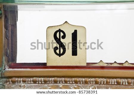 Vintage 1920's cash register pop up dollar sign detail.