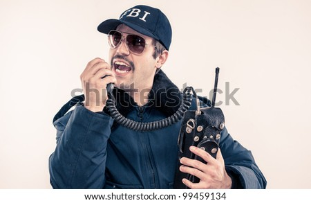 Vintage 1970's USA FBI Agent on CB radio Yelling. Man has moustache and Hat on.