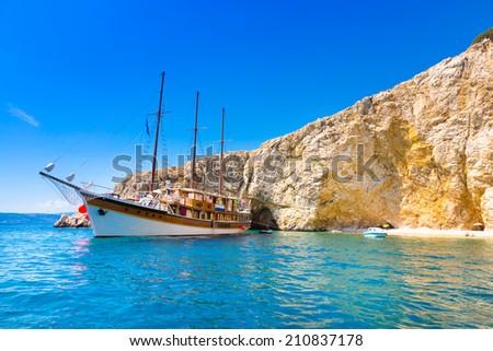 Vintage sailing boat anchored in an idyllic bay on Krk island in Croatia in Mediterranean sea. #210837178