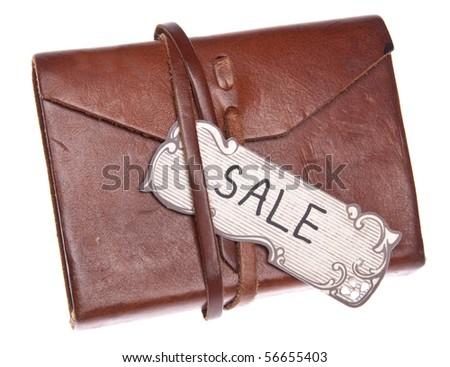 Vintage Sale Tag on an Old Leather Journal Isolated on White with a Clipping Path.