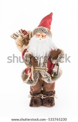 vintage Santa Claus doll with a bag of presents Imagine de stoc ©