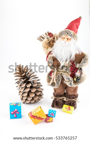 vintage Santa Claus doll with pincone and gift boxes Imagine de stoc ©