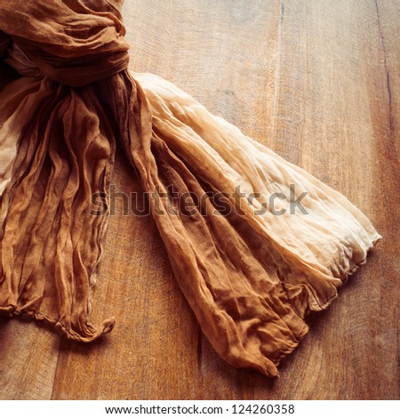 Vintage scarf on wooden table