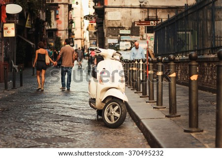 Vintage scooter in old street in Naples, Italy.