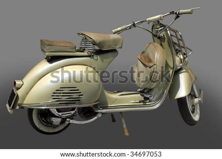 Vintage 1953 scooter isolated over grey background.
