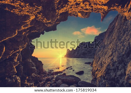 Vintage sea sunset from the mountain cave
