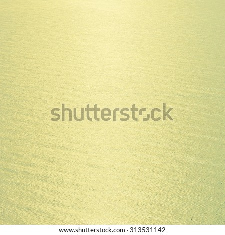 Vintage sea water background with sunflare light from sun - Vintage filter effect