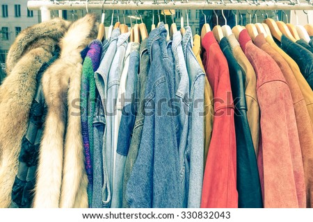 Shutterstock Vintage second hand clothes hanging on shop rack at weekly flea market - Hipster wardrobe sale concept and alternative retro moda fashion styling - Soft desaturated nostalgic filtered look