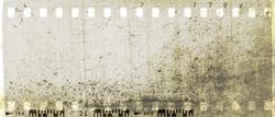 Vintage sepia film strip frame scratched textured.