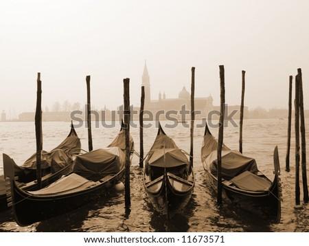 vintage sepia image of Venice gondolas