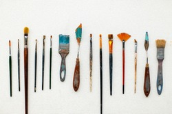 Vintage set of artist. Brushes and tool lies on a white background