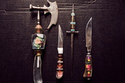 vintage set of old handmade knives for meat on a black background from a private collectionsteel, tool, cut, sharp, vintage, weapon, danger, handmade, retro, set, shiny, hunting, leather, rustic, util