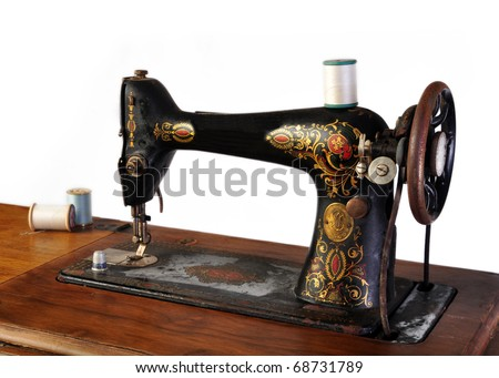 Vintage sewing machine isolated on white background