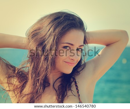 Vintage sexy woman portrait joy on sea background. Closeup