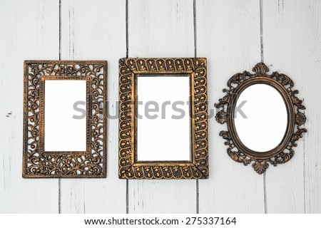 Vintage Shabby chic photo frame set with oval and rectangular frames for wedding bridal photo on a white wooden background