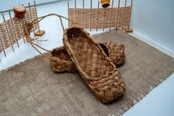Vintage shoes. Museum ekskonat-copy of an ancient wicker shoes.