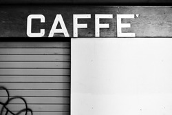 Vintage sign board of a closed cafe in Venice, Italy. Caffe (it.): cafe, coffee