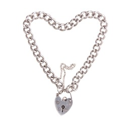 Vintage Silver Charm bracelet in heart shape with padlock against white background.