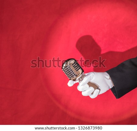 vintage silver microphone on a red stage #1326873980