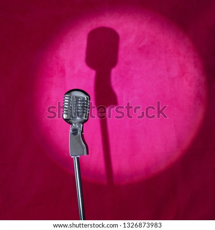 vintage silver microphone on a red stage #1326873983