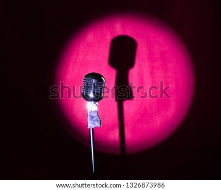 vintage silver microphone on a red stage #1326873986
