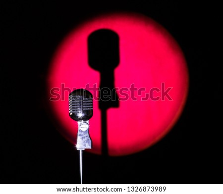 vintage silver microphone on a red stage #1326873989