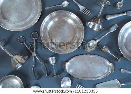 Vintage silverware on gray background