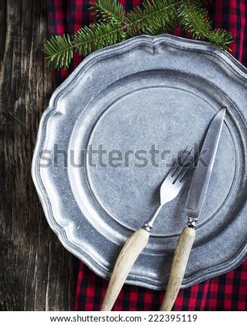 Vintage silverware on rustic metal plate for Christmas Dinner.