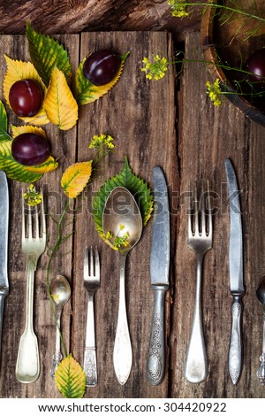 Vintage silverware on rustic wooden background with autumn decoration,  autumn menu Restaurant menu background, Autumn harvest background   Rustic autumn table setting on wooden table