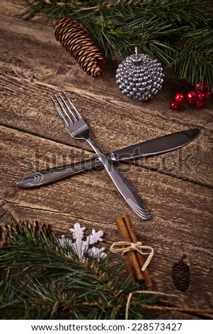 Vintage silverware on rustic wooden background with christmas decoration