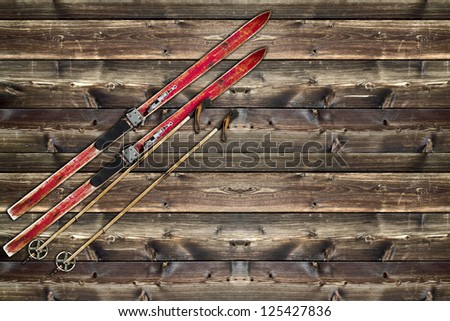 Vintage Ski fixed on wooden wall background