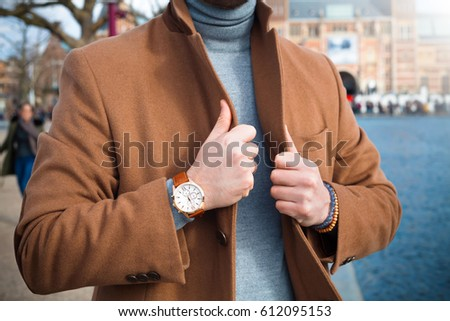 Vintage smart casual outfit outdoor.Fashion model man posing in autumn park.Suited man posing #612095153