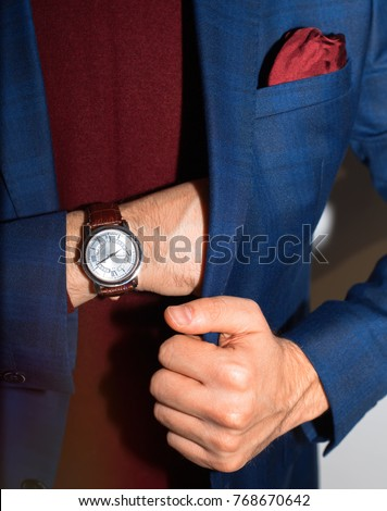 Vintage smart casual outfit outdoor.Fashion model man posing in office.Suited man posing.closeup fashion image of luxury watch on wrist of man.body detail of a business man.Not isolated.