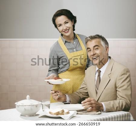 vintage smiling woman serving...