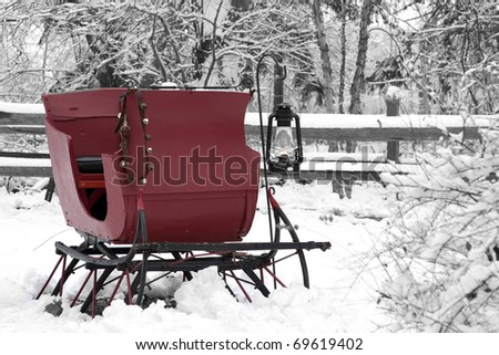 Vintage Snow Sleigh with an oil lantern
