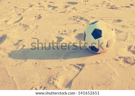 Vintage Soccer ball on sand